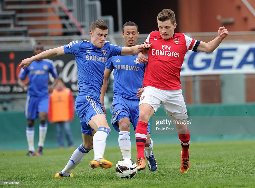 Thomas Eisfeld of Arsenal tries to poke the ball past Kevin Wright of Chelsea during the NextGen Series Semi Final match between Arsenal and Chelsea at Stadio Guiseppe Sinigallia on March 29, 2013 in Como, Italy.
