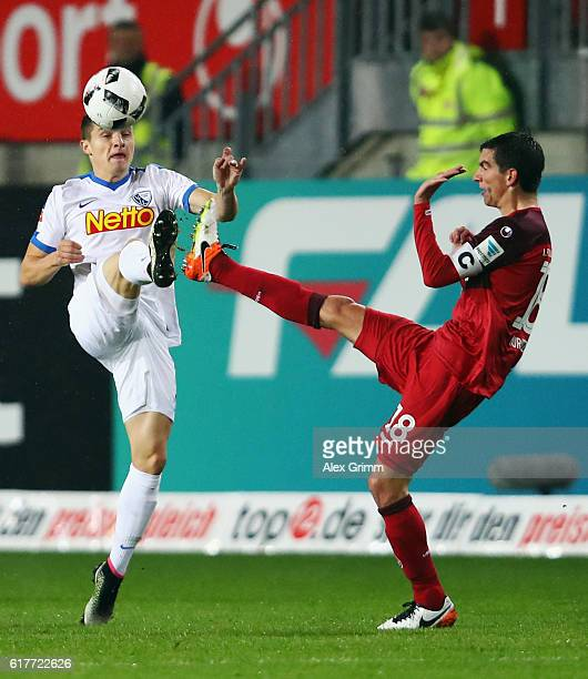 Thomas Eisfeld of Bochum is challenged by Christoph Moritz of Kaiserslautern during the Second Bundesliga match between 1 FC Kaiserslautern and VfL...