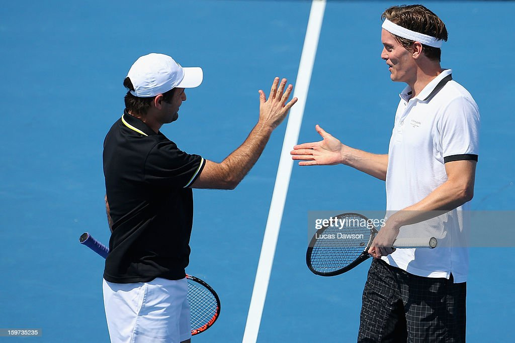 Thomas Enqvist of Sweden Fabrice Santoro of France celebrate a point in their first round legends match against Pat Cash and Wayne Arthurs of Australia during day seven of the 2013 Australian Open at Melbourne Park on January 20, 2013 in Melbourne, Australia.
