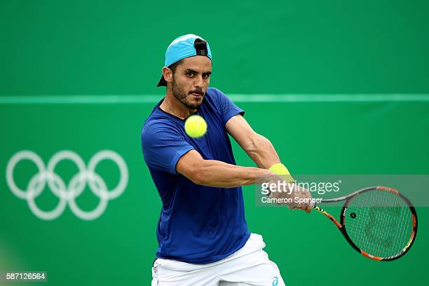 Thomas Fabbiano of Italy plays a backhand against Rogerio Dutra Silva of Brazil in their first round match on Day 2 of the Rio 2016 Olympic Games at...