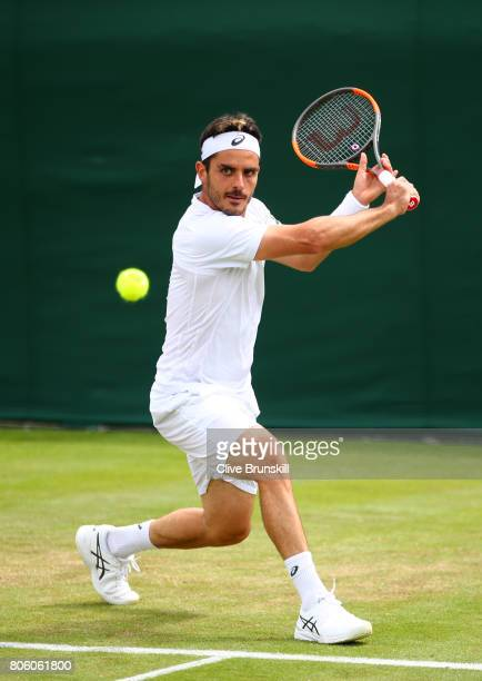 Thomas Fabbiano of Italy plays a backhand during the Gentlemen's Singles first round match against Sam Querrey of the United States on day one of the...