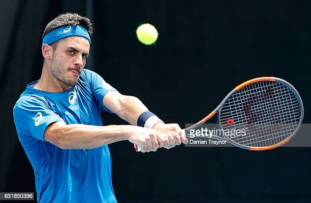 Thomas Fabbiano of Italy plays a backhand in his first round match against Donald Young of the USA on day two of the 2017 Australian Open at...