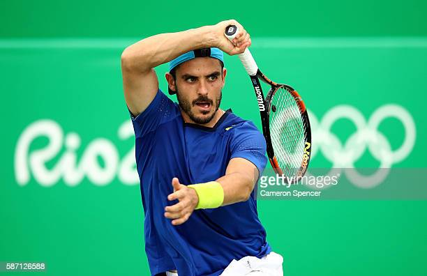 Thomas Fabbiano of Italy plays a forehand against Rogerio Dutra Silva of Brazil in their first round match on Day 2 of the Rio 2016 Olympic Games at...