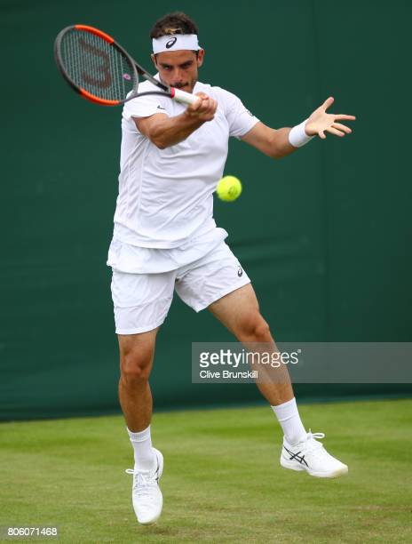 Thomas Fabbiano of Italy plays a forehand during the Gentlemen's Singles first round match against Sam Querrey of the United States on day one of the...