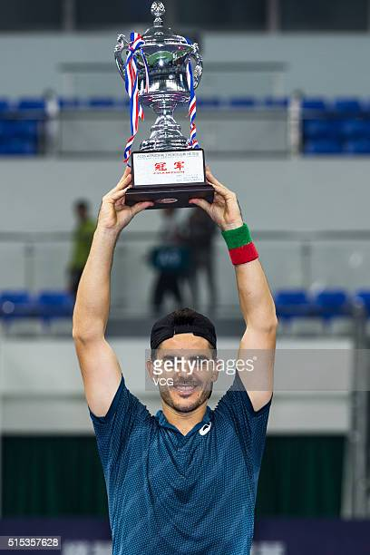 Thomas Fabbiano of Italy poses with trophy after winning men's singles final match against Zhang Ze of China during 2016 ATP Zhuhai Challenger on...