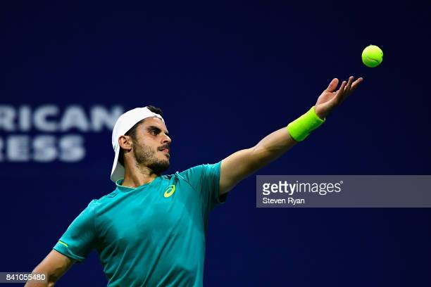 Thomas Fabbiano of Italy serves against Jordan Thompson of Australia during their second round Men's Singles match on Day Three of the 2017 US Open...