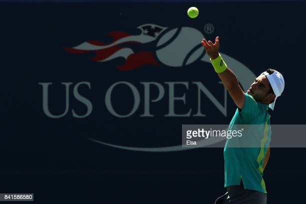 Thomas Fabbiano of Italy serves to Paolo Lorenzi of Italy during their third round match on Day Five of the 2017 US Open at the USTA Billie Jean King...