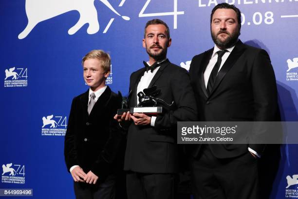 Thomas Gioria Xavier Legrand and Denis Menochet pose with the Silver Lion for Best Director Award for 'Jusqu'à la Garde' and the 'Luigi De...