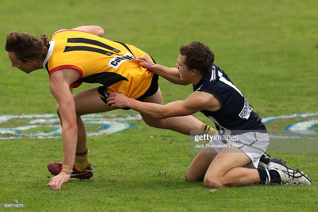 Thomas Glen of the Dandenong Stingrays (L) is tackled by Lachlan Noble of the Geelong Falcons during the round eight TAC Cup match between Dandenong Stingrays and Geelong Falcons at Shepley Oval on May 29, 2016 in Melbourne, Australia.