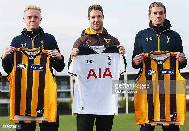 Thomas Glover and Luke McGee of Tottenham pose with James Frawley of the Hawks after they exchanged jumpers during a Tottenham Hotspur player visit...