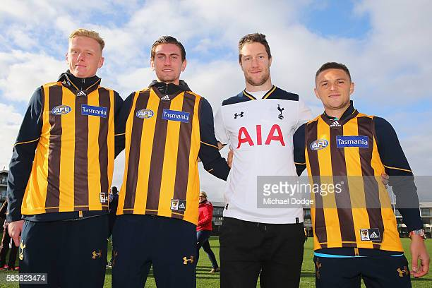 Thomas Glover Luke McGee and Kieran Trippier of Tottenham pose with James Frawley of the Hawks after they exchanged jumpers during a Tottenham...