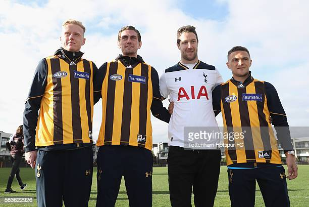 Thomas Glover Luke McGee James Frawley and Kieran Trippier pose during a Tottenham Hotspur player visit to the Hawthorn Hawks AFL team at Waverley...