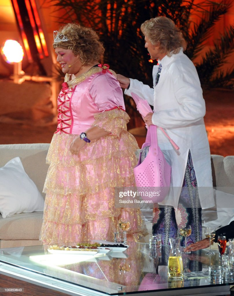 Thomas Gottschalk helps Cindy aus Marzahn to change her dress during the Wetten Dass...? Summer Edition on May 23, 2010 in Palma de Mallorca, Spain.