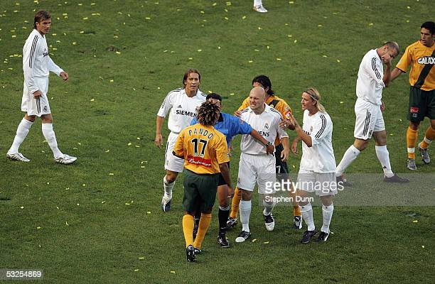 Thomas Gravesen of Real Madrid and Guillermo Ramirez of the Los Angeles Galaxy argue after Ramirez fouled two Madrid players during the start of the...