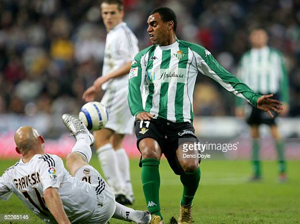 Thomas Gravesen of Real Madrid robs the ball from Denilson of Betis during the La Liga match between Real Madrid and Real Betis on March 2 2005 at...