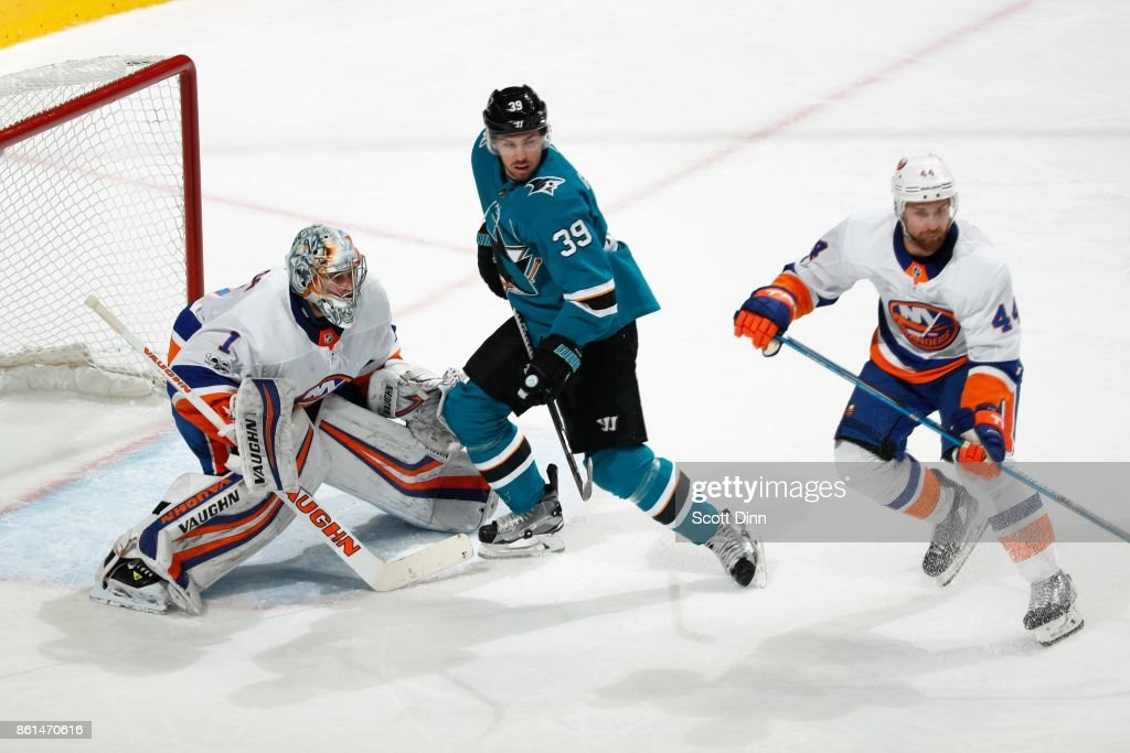 Thomas Greiss #1 and Calvin de Haan #44 of the New York Islanders defend the net against Logan Couture #39 of the San Jose Sharks at SAP Center on October 14, 2017 in San Jose, California.