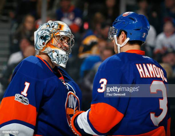 Thomas Greiss and Travis Hamonic of the New York Islanders talk during a break in action in an NHL hockey game against the Boston Bruins at the...