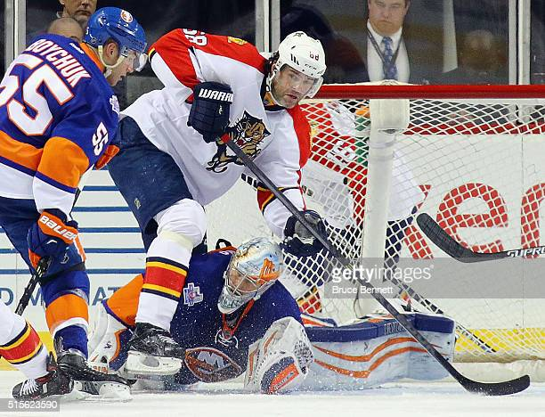 Thomas Greiss of the New York Islanders and Jaromir Jagr of the Florida Panthers keep their eyes on the puck during the second period at the Barclays...
