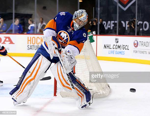 Thomas Greiss of the New York Islanders clears the puck in the first period against the Nashville Predators at the Barclays Center on October 15 2015...