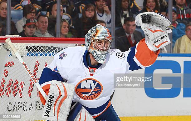 Thomas Greiss of the New York Islanders makes a glove save against the Buffalo Sabres during an NHL game on December 31 2015 at the First Niagara...