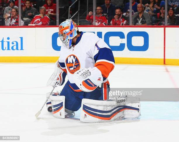 Thomas Greiss of the New York Islanders makes a save against the New Jersey Devils during the game at Prudential Center on February 18 2017 in Newark...