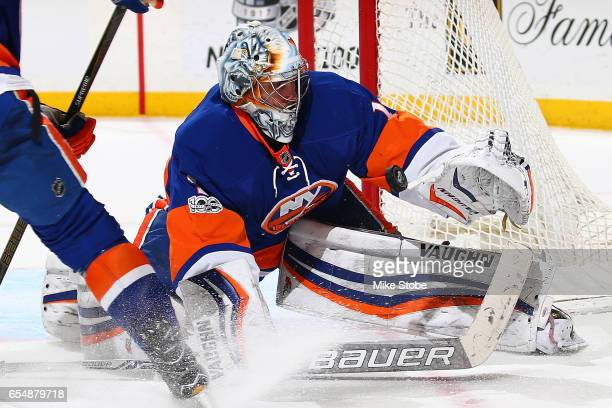 Thomas Greiss of the New York Islanders makes a save against the Columbus Blue Jackets at the Barclays Center on March 18 2017 in Brooklyn borough of...
