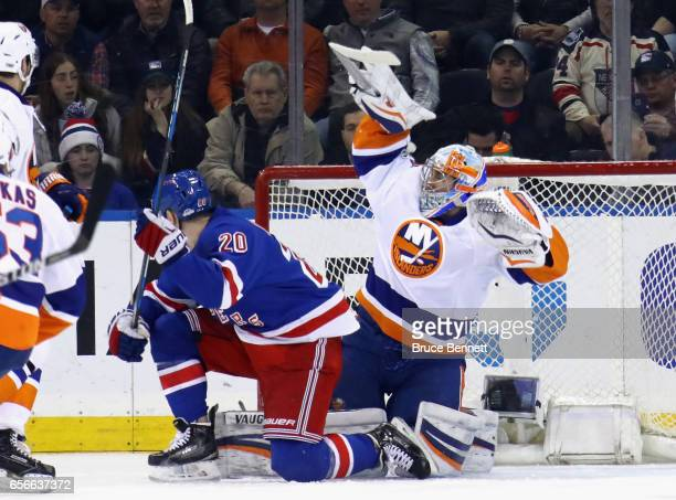 Thomas Greiss of the New York Islanders makes the first period save against the New York Rangers at Madison Square Garden on March 22 2017 in New...