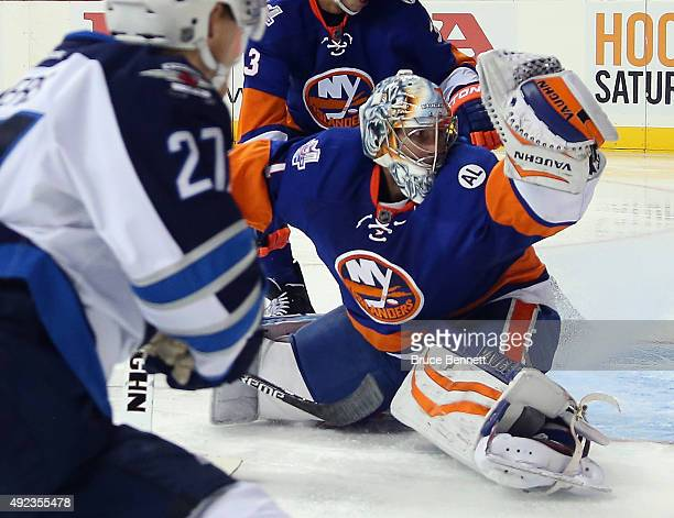 Thomas Greiss of the New York Islanders makes the third period save on Nikolaj Ehlers of the Winnipeg Jets at the Barclays Center on October 12 2015...
