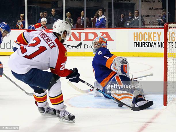 Thomas Greiss of the New York Islanders makes the third period save on Vincent Trocheck of the Florida Panthers at the Barclays Center on March 14...