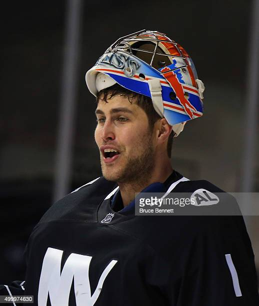 Thomas Greiss of the New York Islanders speaks with the referee during the first period against the St Louis Blues at the Barclays Center on December...