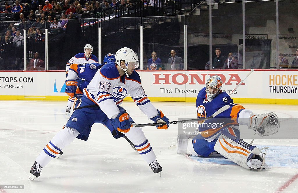 <a gi-track='captionPersonalityLinkClicked' href=/galleries/search?phrase=Thomas+Greiss&family=editorial&specificpeople=695275 ng-click='$event.stopPropagation()'>Thomas Greiss</a> #1 of the New York Islanders stops a shot by <a gi-track='captionPersonalityLinkClicked' href=/galleries/search?phrase=Benoit+Pouliot&family=editorial&specificpeople=879830 ng-click='$event.stopPropagation()'>Benoit Pouliot</a> #67 of the Edmonton Oilers at the Barclays Center on February 7, 2016 in the Brooklyn borough of New York City. The Islanders defeated the Oilers 8-1.