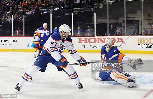 Thomas Greiss of the New York Islanders stops a shot by Benoit Pouliot of the Edmonton Oilers at the Barclays Center on February 7 2016 in the...