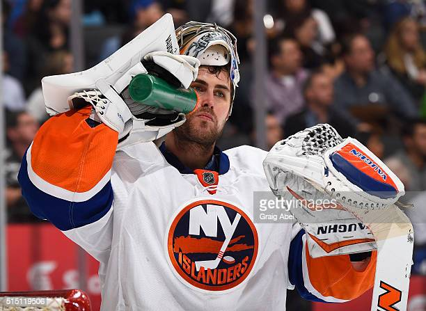 Thomas Greiss of the New York Islanders takes a water break during a stop in the action against the Toronto Maple Leafs on March 9 2016 at Air Canada...