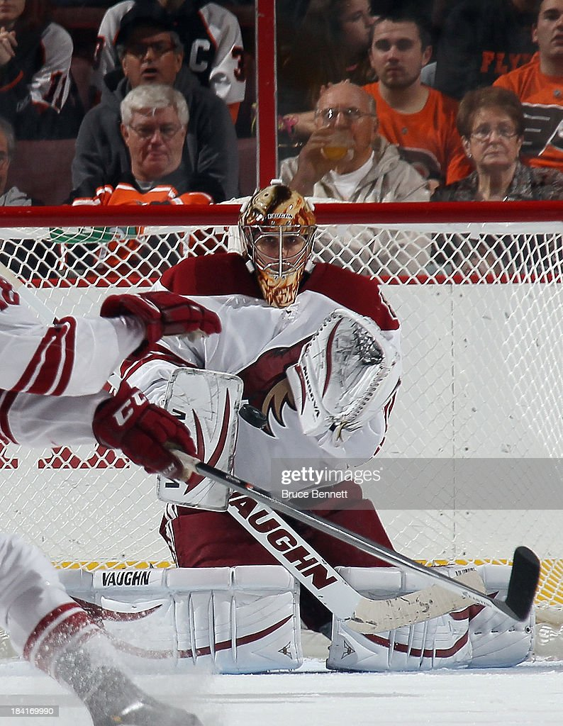 Thomas Greiss #1 of the Phoenix Coyotes makes the third period chest save against the Philadelphia Flyers at the Wells Fargo Center on October 11, 2013 in Philadelphia, Pennsylvania. The Coyotes defeated the Flyers 2-1.