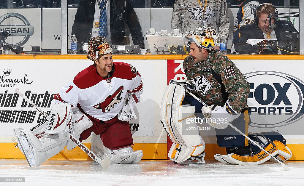 <a gi-track='captionPersonalityLinkClicked' href=/galleries/search?phrase=Thomas+Greiss&family=editorial&specificpeople=695275 ng-click='$event.stopPropagation()'>Thomas Greiss</a> #1 of the Phoenix Coyotes talks with <a gi-track='captionPersonalityLinkClicked' href=/galleries/search?phrase=Carter+Hutton&family=editorial&specificpeople=6872781 ng-click='$event.stopPropagation()'>Carter Hutton</a> #30 of the Nashville Predators during warmups at Bridgestone Arena on November 25, 2013 in Nashville, Tennessee.