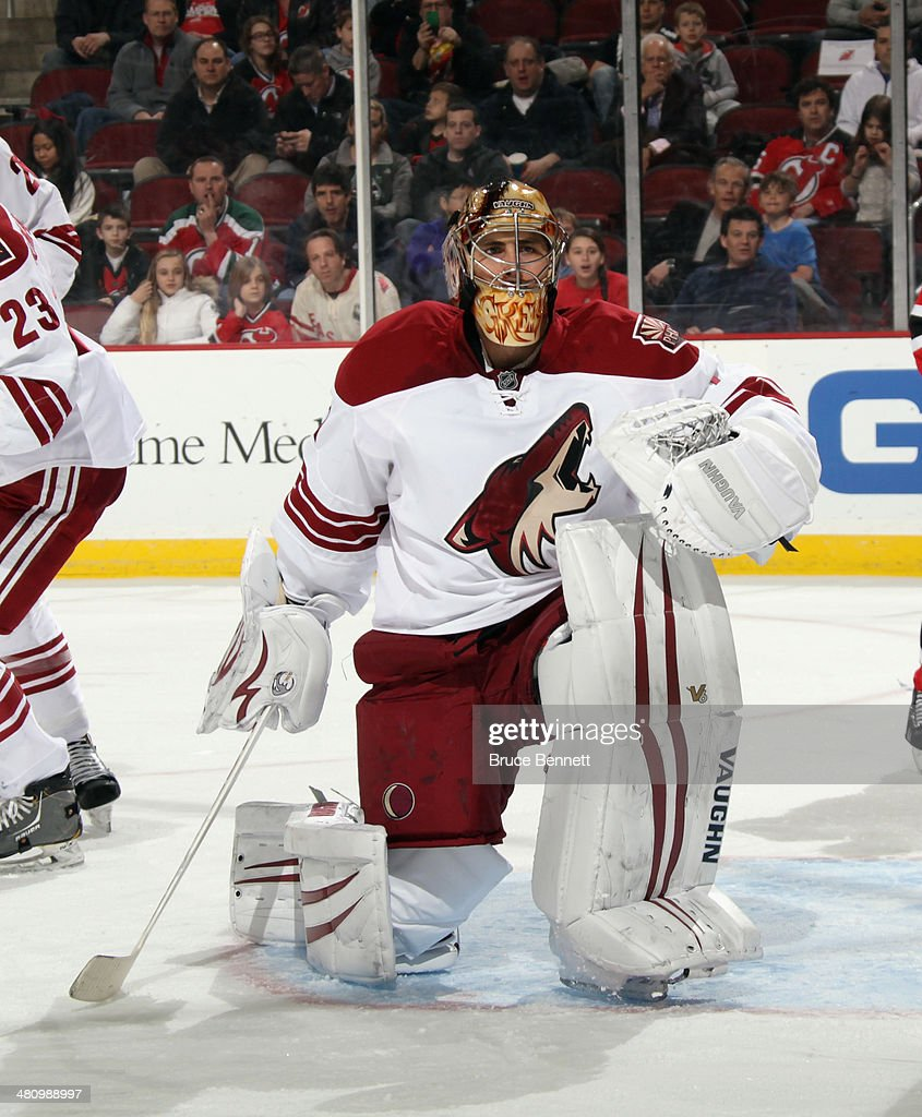 <a gi-track='captionPersonalityLinkClicked' href=/galleries/search?phrase=Thomas+Greiss&family=editorial&specificpeople=695275 ng-click='$event.stopPropagation()'>Thomas Greiss</a> #1 of the Phoenix Coyotes tends net against the New Jersey Devils at the Prudential Center on March 27, 2014 in Newark, New Jersey. The Coyotes defeated the Devils 3-2 in the shootout.