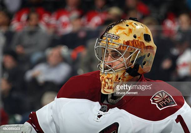 Thomas Greiss of the Phoenix Coyotes tends net against the New Jersey Devils at the Prudential Center on March 27 2014 in Newark New Jersey The...
