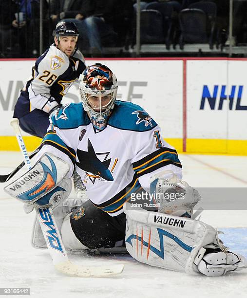 Thomas Greiss of the San Jose Sharks makes a glove save against Steve Sullivan of the Nashville Predators on November 17 2009 at the Sommet Center in...