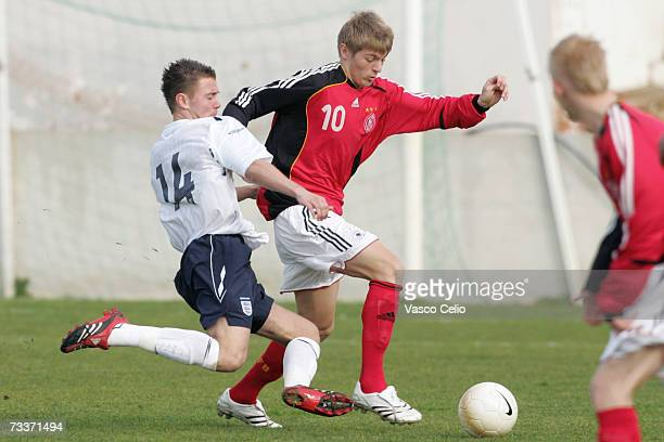 Thomas Harvey of England challenges Toni Kroos of Germany during the Men's U17 international Tournament match between Englad and Germany at the...