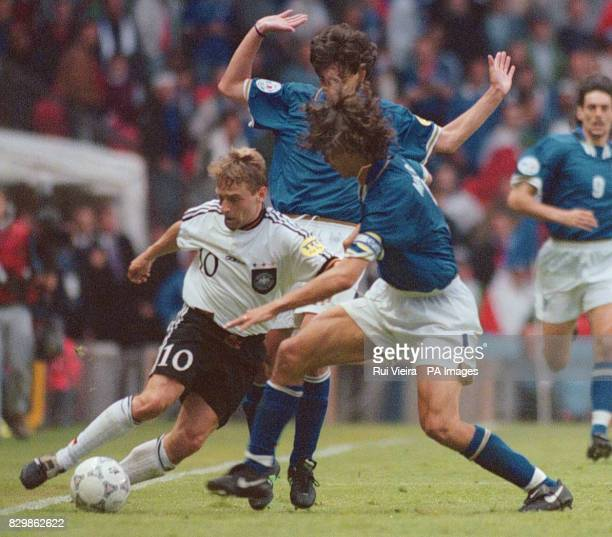 Thomas Hassler comes under pressure from Paolo Maldini Demetrio Albertini during tonight's Euro 96 match at Old Trafford Photo by Rui Vieira/PA