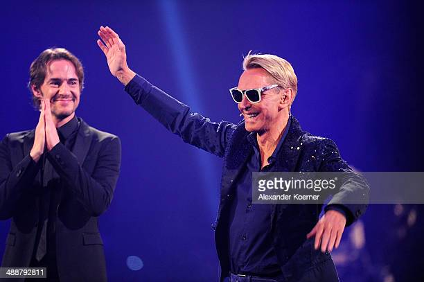 Thomas Hayo and Wolfgang Joop are puctired during the final of Germany's Next Top Model«TV show at Lanxess Arena on May 8 2014 in Cologne Germany The...