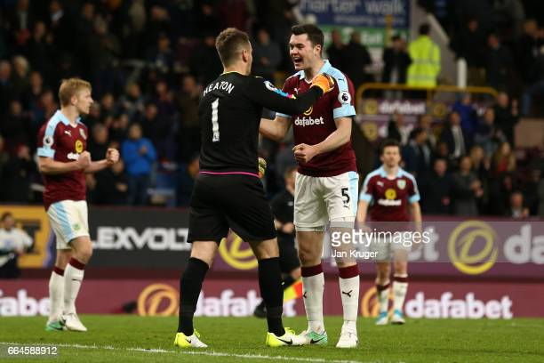 Thomas Heaton of Burnley and Michael Keane of Burnley celebrate together after the Premier League match between Burnley and Stoke City at Turf Moor...