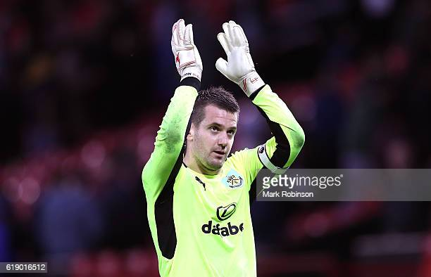 Thomas Heaton of Burnley applauds fans after the final whistle during the Premier League match between Manchester United and Burnley at Old Trafford...