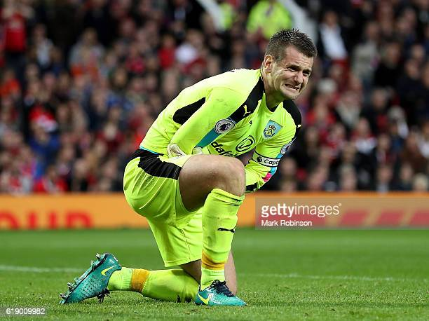 Thomas Heaton of Burnley holds his arm during the Premier League match between Manchester United and Burnley at Old Trafford on October 29 2016 in...