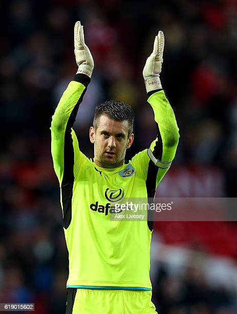 Thomas Heaton of Burnley shows the appreciation to the fans after the final whistle during the Premier League match between Manchester United and...