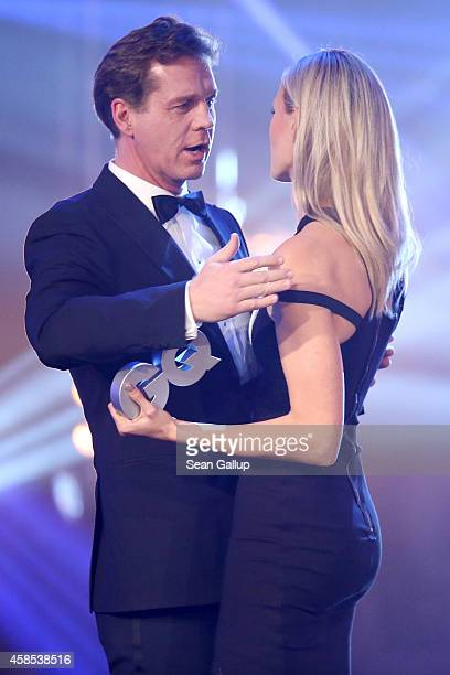 Thomas Heinze and Karolina Kurkova are seen on stage at the GQ Men Of The Year Award 2014 at Komische Oper on November 6 2014 in Berlin Germany