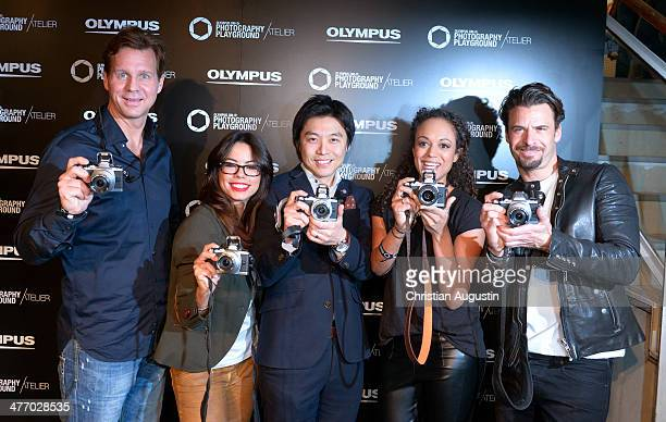 Thomas Heinze Fernanda Brandao Akihiko Murata Milka Loff Fernades and Stephan Luca attend opening of 'Olympus OMD Photography Playground' on March 6...