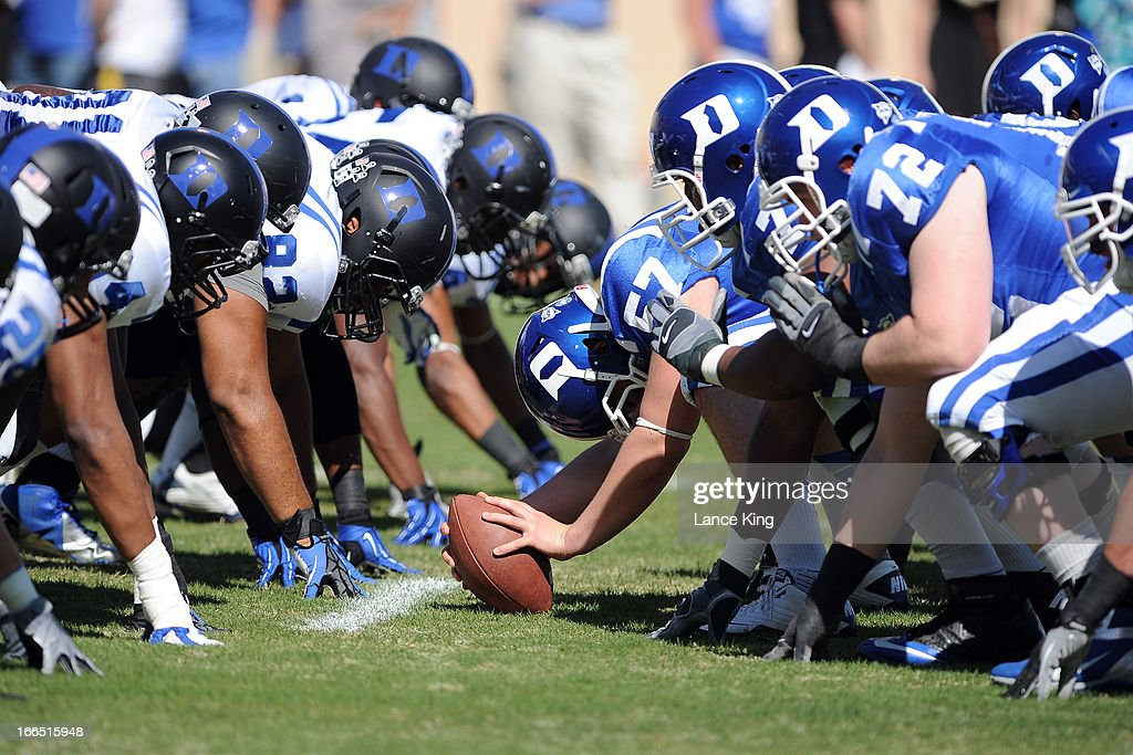 Thomas Hennessy #57 of the Duke Blue Devils prepares to snap the ball during their Spring Game at Wallace Wade Stadium on April 13, 2013 in Durham, North Carolina.