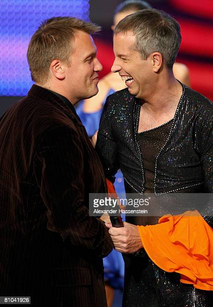 Thomas Hermanns congratulates Hape Kerkeling during the Bavarian Television Award 2008 at the Prinzregenten Theatre on 9 May 2009 in Munich Germany