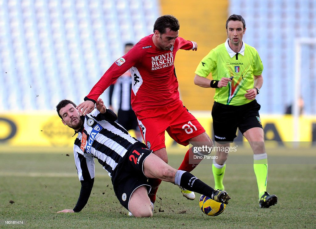 Thomas Hertaux (L) of Udinese Calcio competes with Erjon Bogdani of AC Siena during the Serie A match between Udinese Calcio and AC Siena at Stadio Friuli on January 27, 2013 in Udine, Italy.